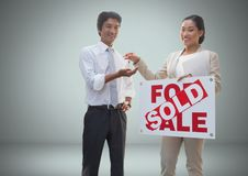 Man and woman with for sale sign and keys in front of vignette Royalty Free Stock Photo
