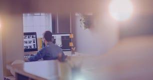 Man working in hazy glow room. Digital composite of Man working in hazy glow room Stock Image