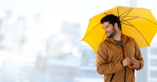 Man with yellow umbrella and bright background Royalty Free Stock Photography