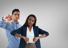 man and woman with thumbs down royalty free stock image