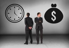 Money bag and clock time with Businessman looking in opposite directions. Digital composite of Money bag and clock time with Businessman looking in opposite stock image
