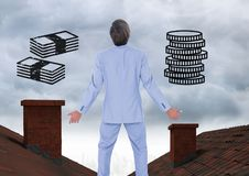 Money icons and Businessman standing on Roofs with chimney and cloudy sky Stock Image