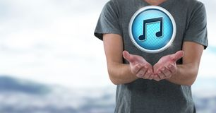 Music note icon and hands palm open in landscape Royalty Free Stock Image