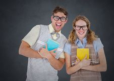 Nerd couple against grey background with grunge overlay Royalty Free Stock Photography