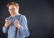 Nerd man pointing against navy chalkboard Royalty Free Stock Images