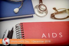 Digital composite of news flash with medical imagery. World AIDS Day 2018 royalty free stock photo
