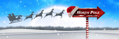 North Pole text on Wooden signpost in Christmas Winter landscape and Santa`s sleigh and reindeer`s. Digital composite of North Pole text on Wooden signpost in royalty free illustration