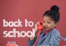 Office kid girl talking on the phone with back to school text against red background Stock Images