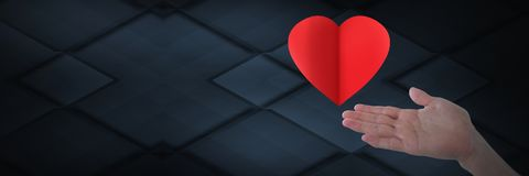 Open hand and heart. Digital composite of open hand and heart Royalty Free Stock Images