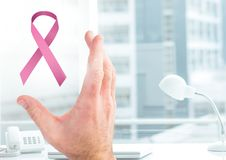 Open hand with pink ribbon for breast cancer awareness Royalty Free Stock Images