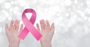 Open hands with pink ribbon for breast cancer awareness. Digital composite of Open hands with pink ribbon for breast cancer awareness royalty free stock photo
