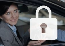 Padlock icon against happy woman in the car Royalty Free Stock Photos