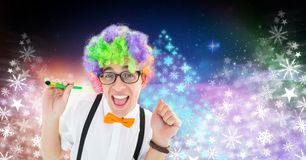 Party man with funny colorful hair and Snowflake Christmas tree colorful pattern shapes for New Year. Digital composite of Party man with funny colorful hair and Royalty Free Stock Photo