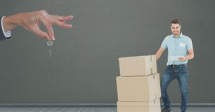 people moving boxes into new home with key royalty free stock image