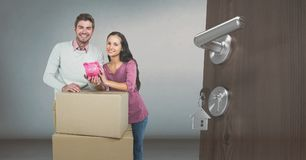 People moving boxes into new home. Digital composite of people moving boxes into new home Royalty Free Stock Image