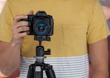 photographer with camera on tripod. Bokeh background Royalty Free Stock Photos