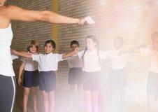 Physical education teacher with class. Digital composite of Physical education teacher with class stock photos