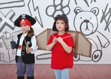 Pirate girl and pilot boy in room with kids drawing graphics. Digital composite of Pirate girl and pilot boy in room with kids drawing graphics royalty free stock photos