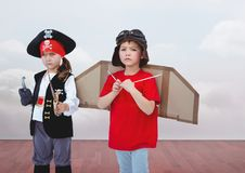 Pirate girl and pilot boy in room. Digital composite of Pirate girl and pilot boy in room Stock Image
