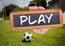 Play text on blackboard with soccer field and football Royalty Free Stock Photography