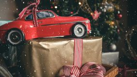 Red model car and a christmas present combined with falling snow stock illustration
