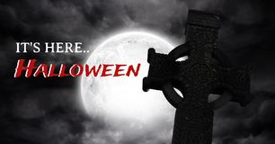 It`s here Halloween text with gothic graveyard and moon Royalty Free Stock Images