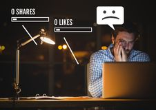 Sad man on laptop with Social media interfaces and no likes Stock Images
