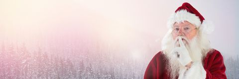 Santa Claus in Winter with hand gesturing to be quiet. Digital composite of Santa Claus in Winter with hand gesturing to be quiet Stock Images