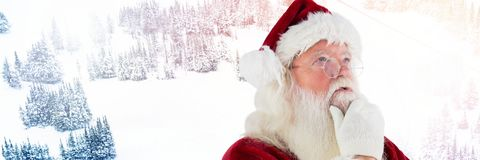 Santa Claus in Winter thinking stock image