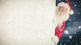Santa clause holding a sign combined with falling snow. Digital composite of Santa clause holding a sign combined with falling snow stock video footage