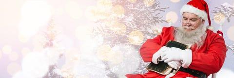 Santa with Winter landscape falling asleep. Digital composite of Santa with Winter landscape falling asleep Royalty Free Stock Photography