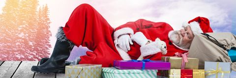 Santa with Winter landscape and gifts Stock Image
