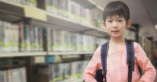 School girl in education library. Digital composite of School girl in education library royalty free stock images