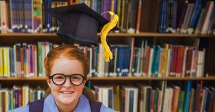 School girl in education library with graduation hat. Digital composite of School girl in education library with graduation hat stock photography