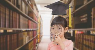 School girl in education library with graduation hat. Digital composite of School girl in education library with graduation hat stock image