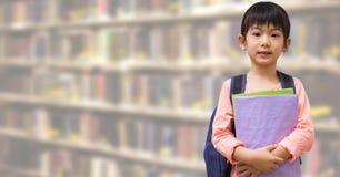 School girl in education library. Digital composite of School girl in education library royalty free stock photos