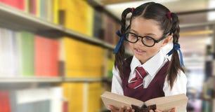 School girl in education library. Digital composite of School girl in education library stock images