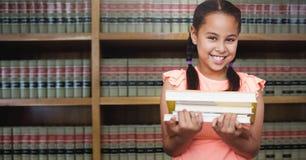 School girl in education library. Digital composite of School girl in education library stock photography