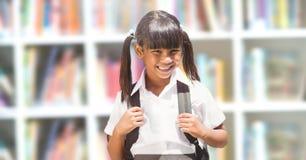 School girl in education library. Digital composite of School girl in education library stock image