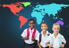 School kids in front of colorful world map Royalty Free Stock Photos