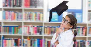 Science School girl in education library with graduation hat. Digital composite of Science School girl in education library with graduation hat royalty free stock photos