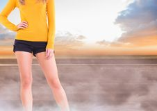 Sexy woman`s legs in mystical landscape with yellow jumper Stock Photography
