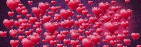 Shiny bubbly Valentines hearts with leaves purple background Stock Images