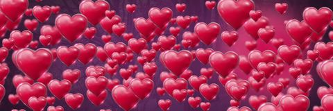 Shiny bubbly Valentines hearts with purple trees background Royalty Free Stock Images