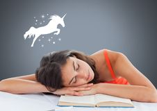 Sleeping woman dreaming of a unicorn and stars. Digital composite of Sleeping woman dreaming of a unicorn and stars Stock Photo