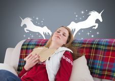 Sleeping woman dreaming of unicorns with book and stars. Digital composite of Sleeping woman dreaming of unicorns with book and stars Royalty Free Stock Photo