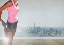 Slim athletic woman in front of city Stock Image
