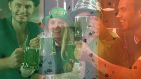 Smiling friends with Irish accessory in the bar. Digital composite of smiling friends with Irish accessory in the bar on st patricks day against green four stock illustration