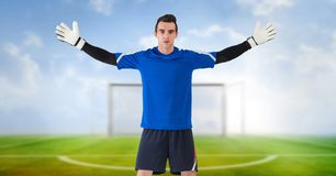 Soccer goalkeeper in goal. Digital composite of Soccer goalkeeper in goal stock photos