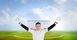 Soccer goalkeeper in goal. Digital composite of Soccer goalkeeper in goal stock image